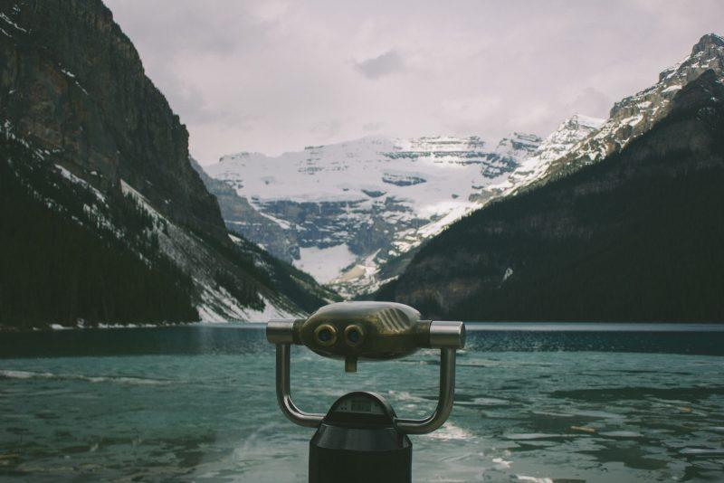 gray telescope over the lake